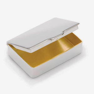 a rectangular sterling silver modern pill box with a gilt interior