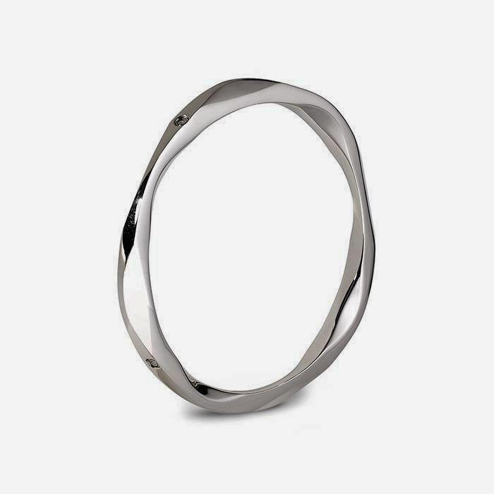 a contemporary orbital design sterling silver bangle with a polished finish