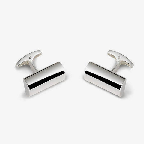 a silver modern set of mens cufflinks with a half pipe shape and plain design