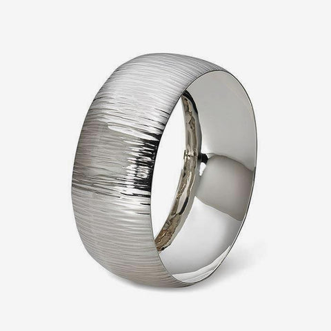 a men's sterling silver bangle which is wide and has a bark pattern throughout