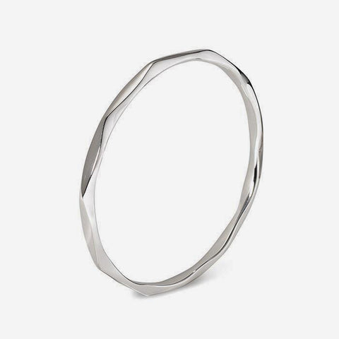 a sterling silver bangle with a wave design by francis howard in sheffield