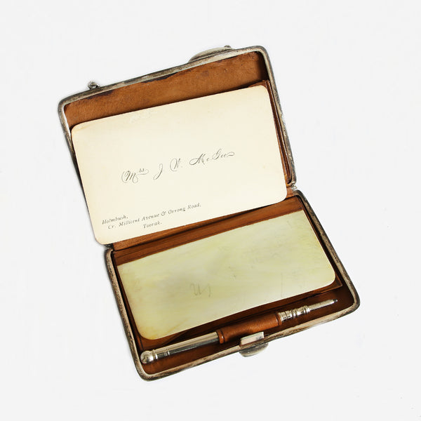 an Edwardian silver finger purse and pencil dated 1904