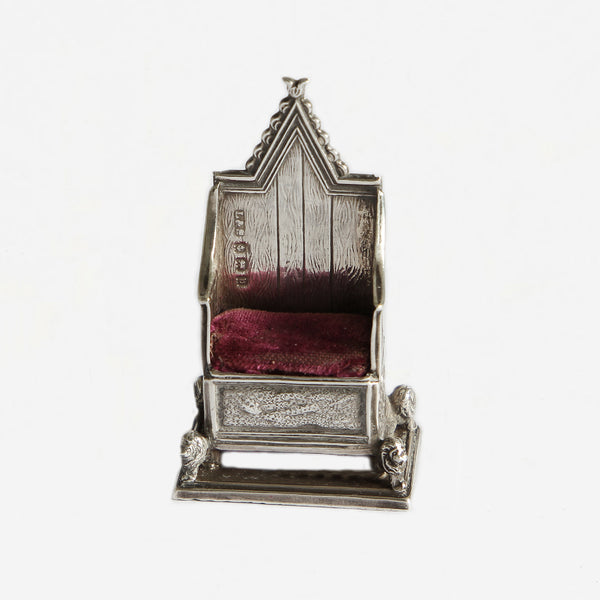 a silver coronation chair miniature pin cushion with hallmark dated 1901