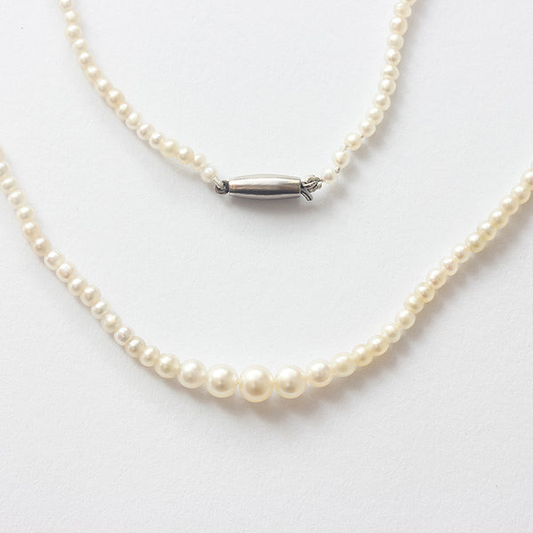 natural pearl antique necklace with a plain torpedo clasp