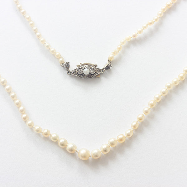 an antique beautiful natural pearl necklet with pearl and diamond clasp