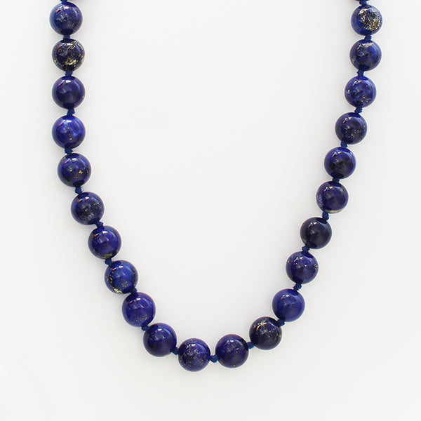 a string of blue lapis lazuli beads with a silver round clasp secondhand