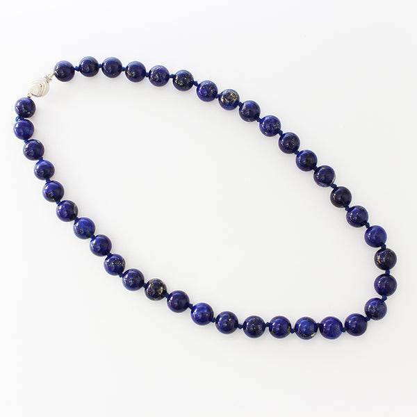 a secondhand string of blue lapis lazuli beads and a silver two tone clasp