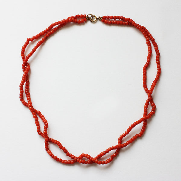 a secondhand double row of coral beads with a bolt ring clasp at marston barrett in lewes