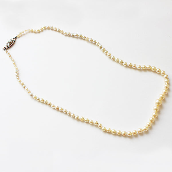 a secondhand single row of pearl necklace with a diamond set clasp