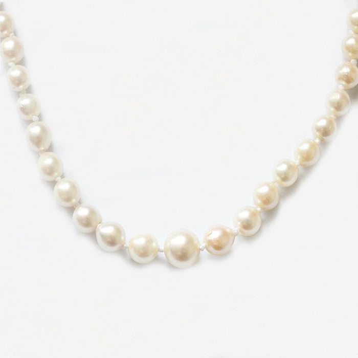 a single row of pearls with a gold ball clasp secondhand