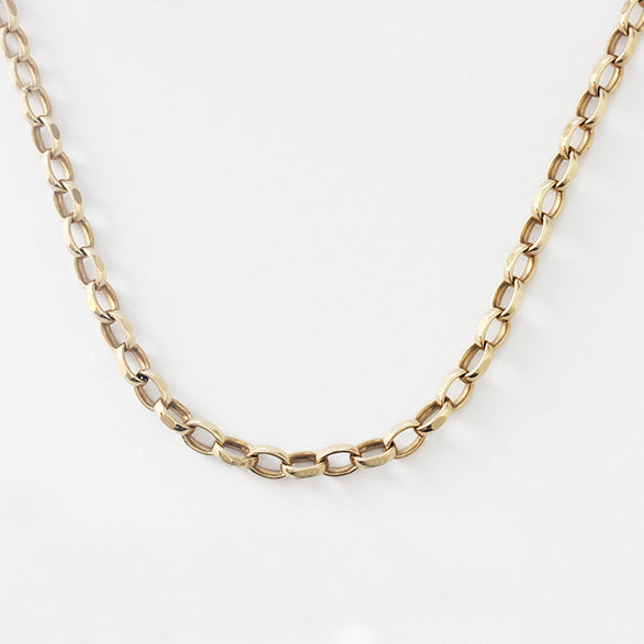 a secondhand faceted oval belcher chain in yellow gold