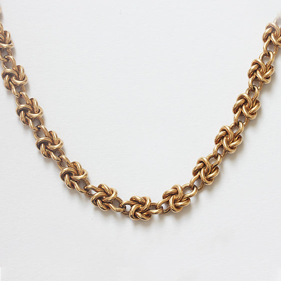 a fine quality secondhand box knot design chain in yellow gold with box snap fastener