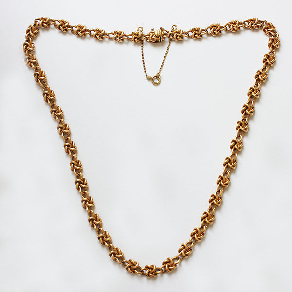 a vintage preowned knot design yellow gold chain with safety chain
