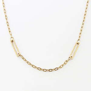 a 1970s yellow gold oval link necklace with  textured rectangle sections