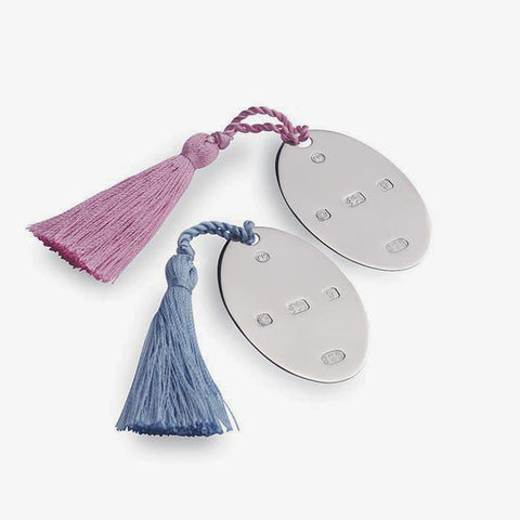 an oval disc with a hallmark all in sterling silver and pink or blue tassels bookmark