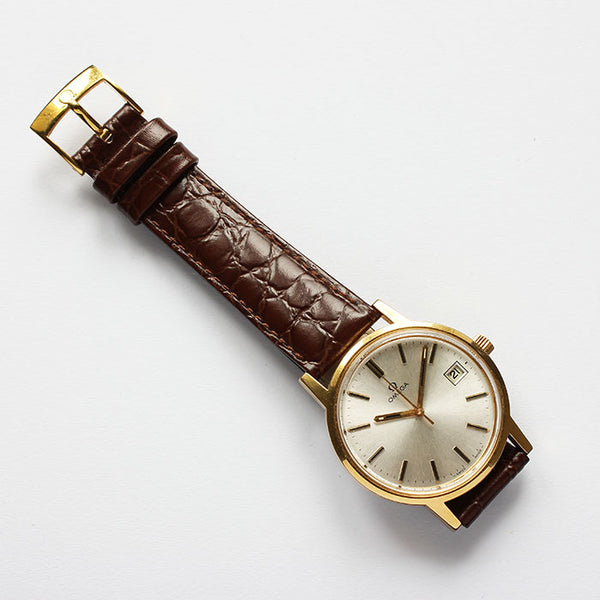 a fine quality vintage omega gold plate watch with date feature and brown leather strap dated 1978