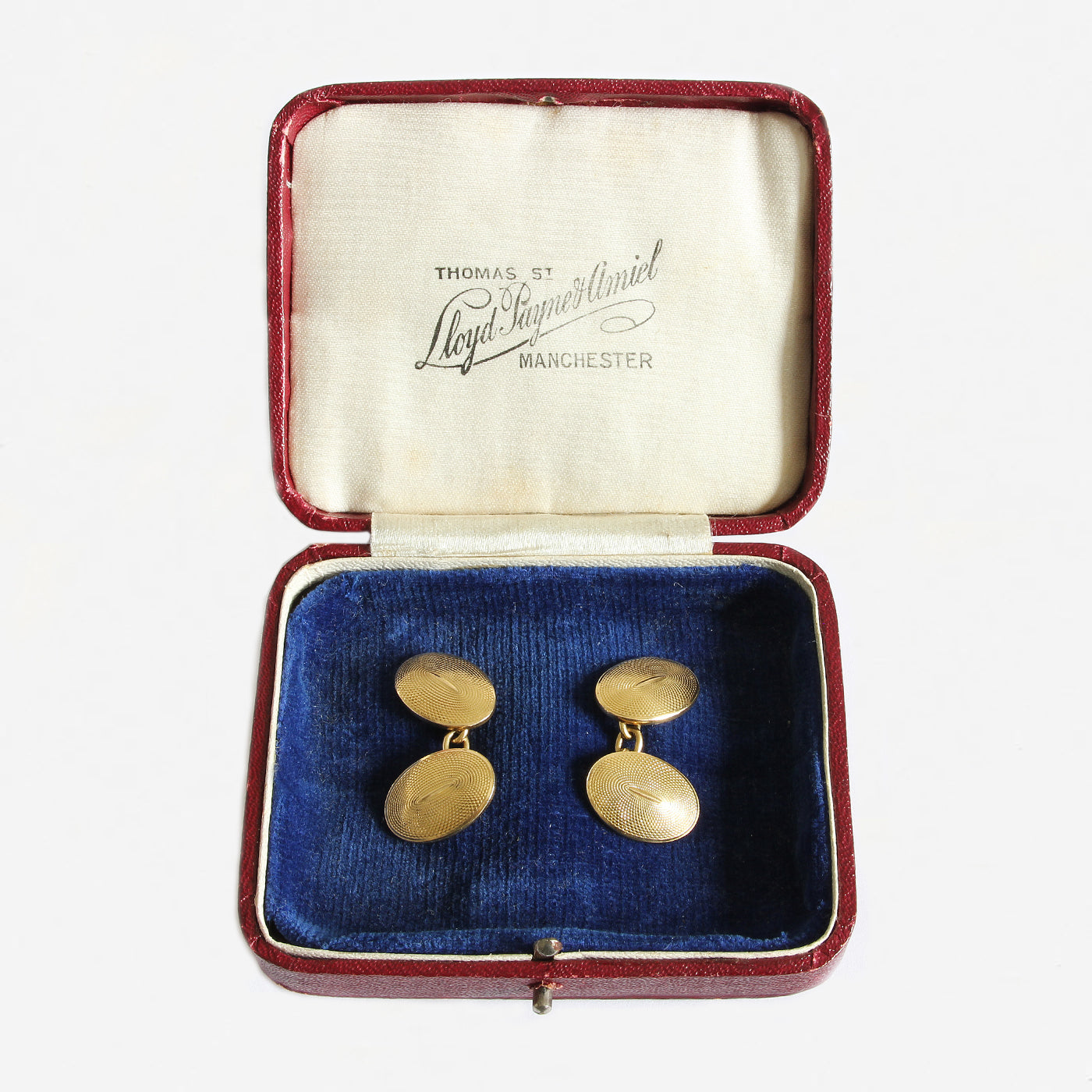 a yellow gold pair of secondhand oval engine turned cufflinks in box with chain connections