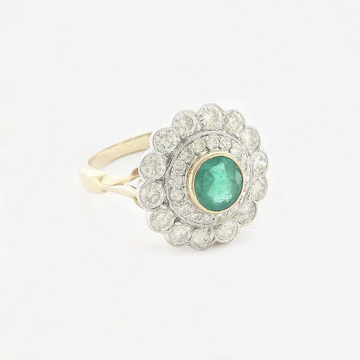 an emerald diamond round large cluster ring in white and yellow gold Edit alt tex
