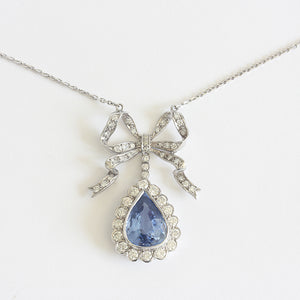 a beautiful sapphire and diamond bow necklace secondhand in white gold