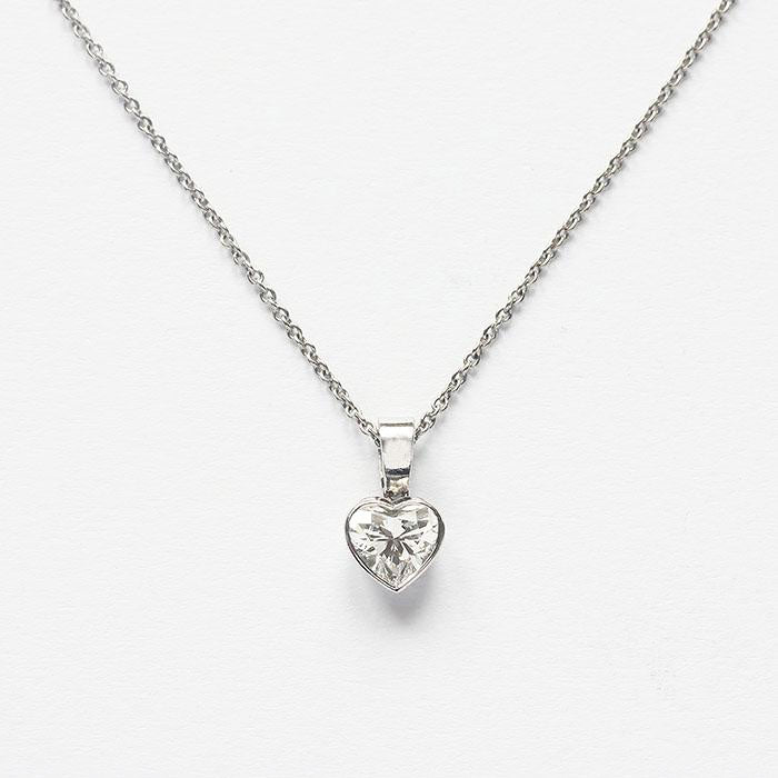 a beautiful heart shaped diamond pendant and trace chain all made in platinum secondhand