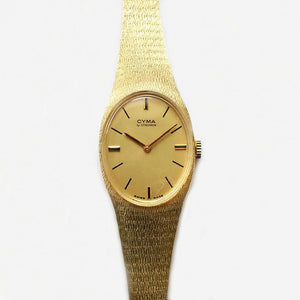 a ladies cyma synchron gold wrist watch with batons secondhand