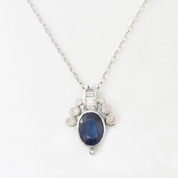 a stunning sapphire and diamond modern rub over pendant necklace in white gold