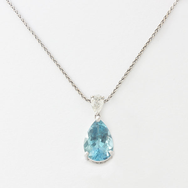 a beautiful pear shaped aquamainre and diamond 2 stone pendant  in white gold with chain