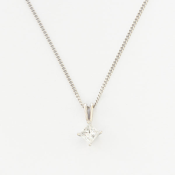 a princess cut single stone diamond pendant in 4 claw setting in  white gold setting and chain