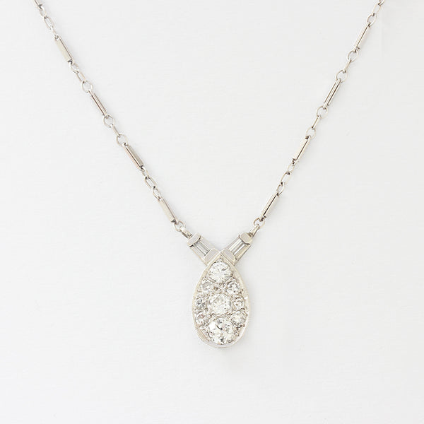 a beautiful marquise shaped diamond set cluster pendant and necklace
