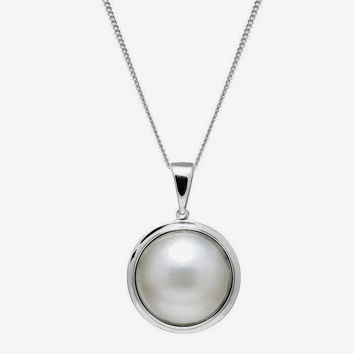a 13mm grey mabe pearl with a rub over setting pendant and a silver fine curb link chain