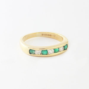 emerald diamond eternity ring yellow gold channel set
