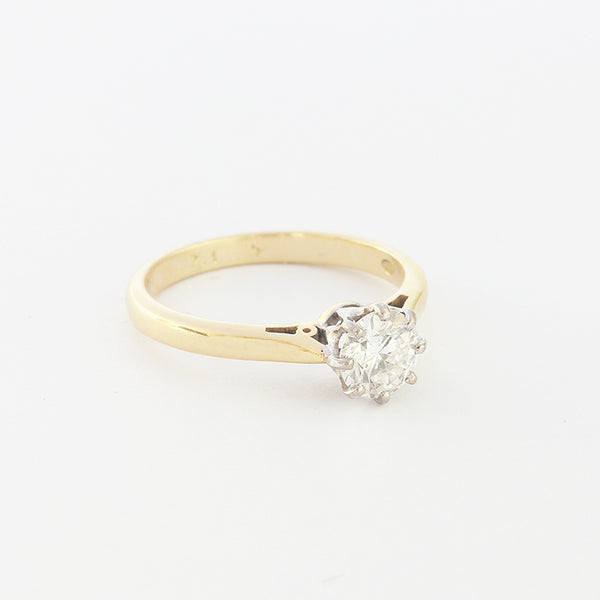 a modern brilliant cut diamond solitaire ring with claws and gold band