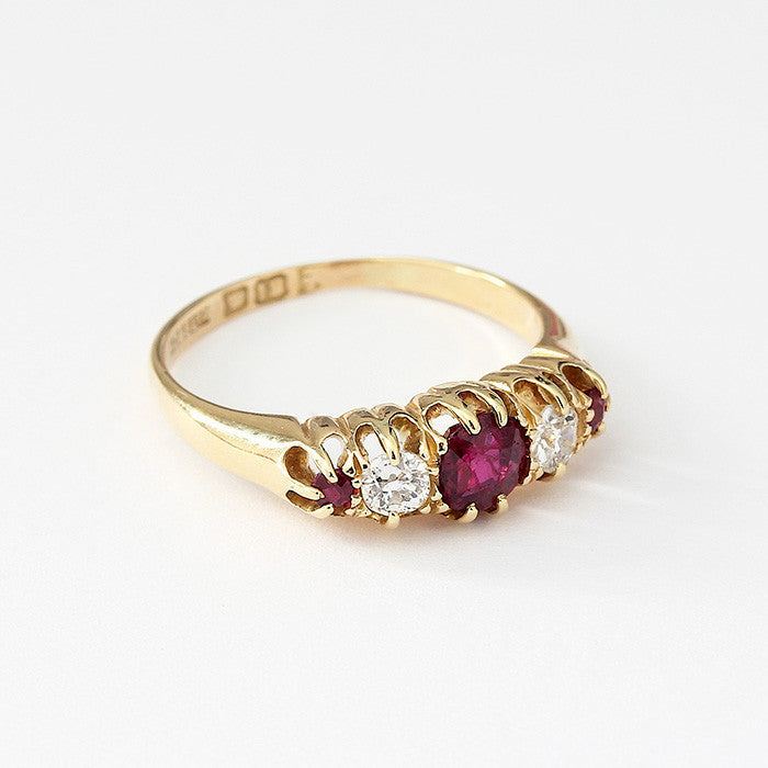 an antique yellow gold 5 stone ruby and diamond graduated ring with a claw setting