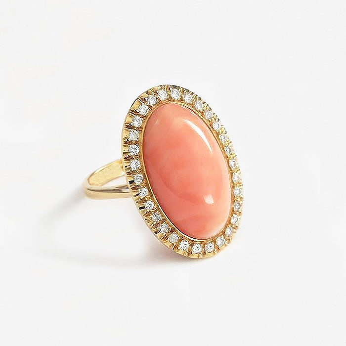 a secondhand coral and diamond large oval cluster with central coral and 30 small diamond surround all in 18ct yellow gold with finger size N