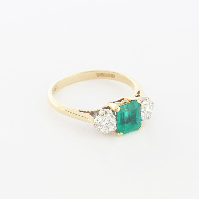 a beautiful secondhand emerald and diamond 3 stone ring in yellow gold