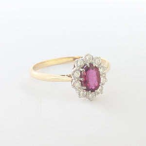 ruby and diamond cluster ring in claw set and yellow white gold
