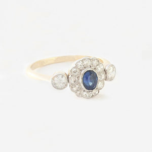 a sapphire diamond daisy cluster ring in yellow gold and platinum
