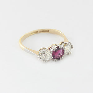 ruby and diamond 3 stone ring in claw setting and yellow gold band