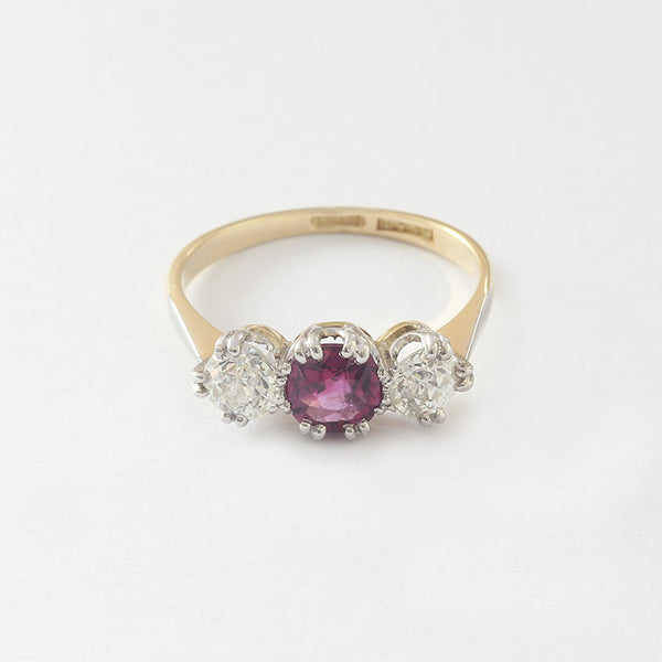 a gold preowned ruby and diamond 3 stone ring in claw setting