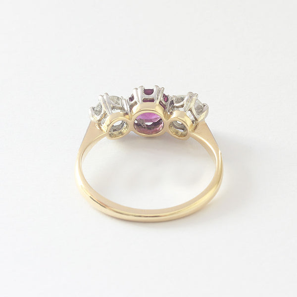a preowned yellow gold ruby and diamond 3 stone ring