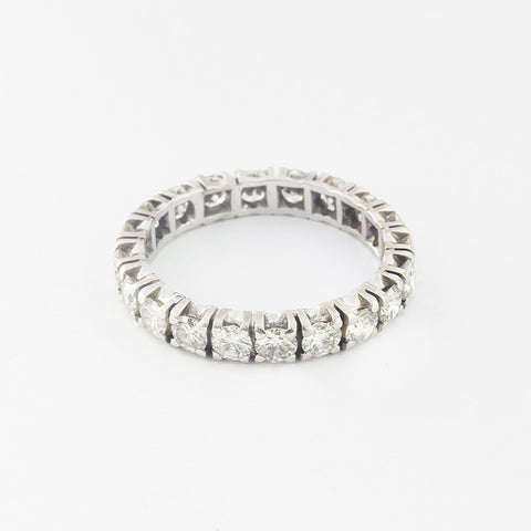 a stunning diamond set full eternity ring in white gold with a claw setting