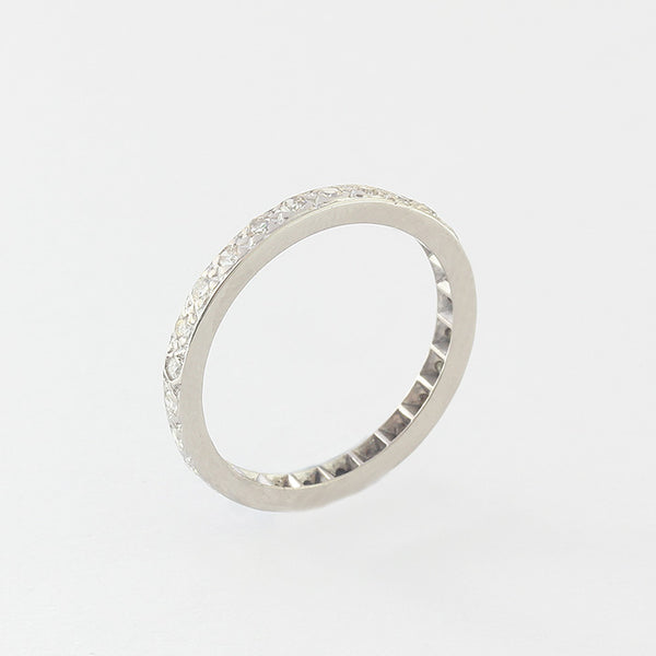 a preowned full eternity ring with round diamonds and set in platinum