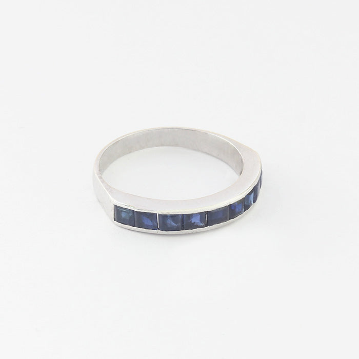 a secondhand white gold sapphire half eternity ring with square sapphires