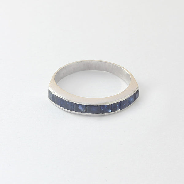 a preowned square set sapphire half eternity ring in white gold