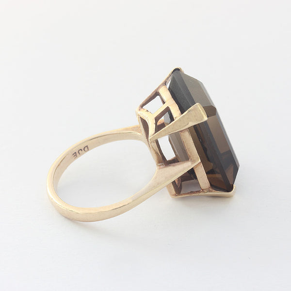 a secondhand yellow gold single stone smokey quartz stone in a claw setting