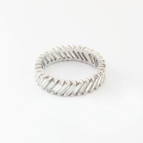a baguette cut diamond set full eternity ring in white gold and claw setting