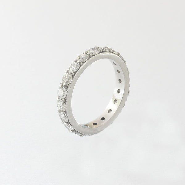 a preowned diamond set full eternity ring with round stones and claw setting