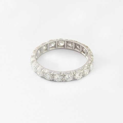 a beautiful diamond set full eternity ring  in 18 carat white gold
