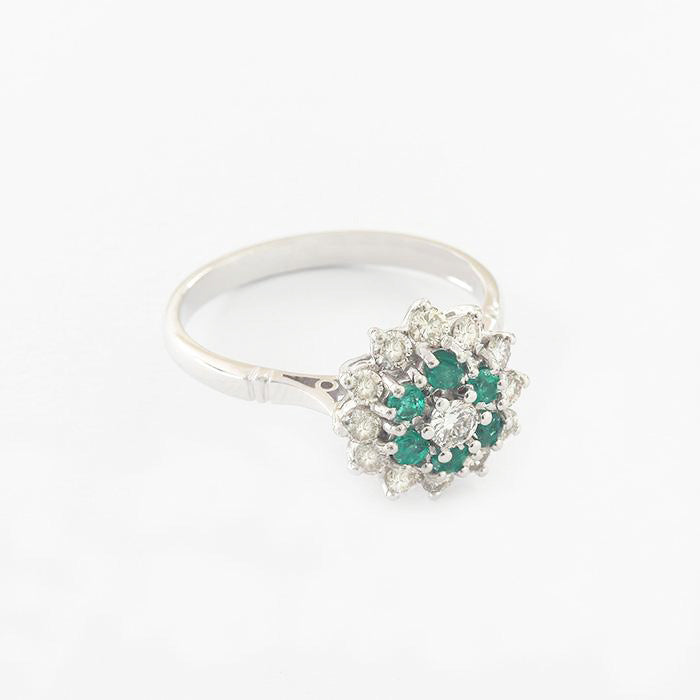 a white gold emerald diamond claw set cluster ring
