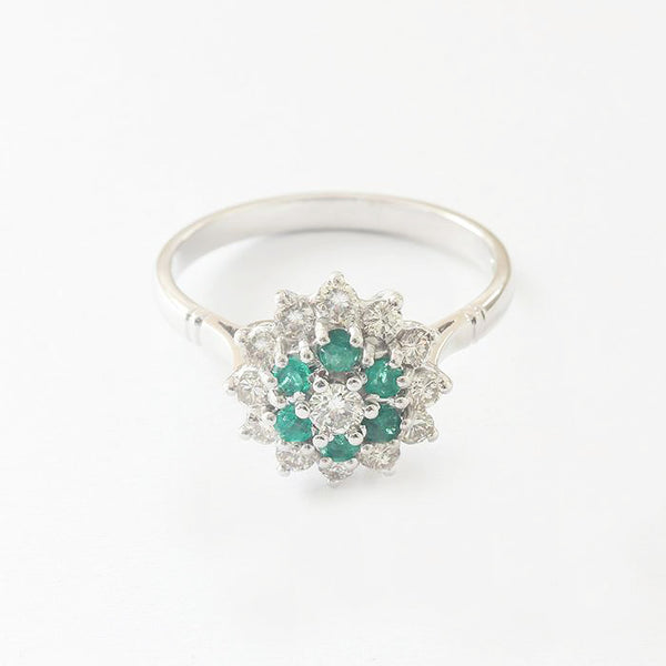 a vintage style white gold diamond and emerald cluster ring marston barrett